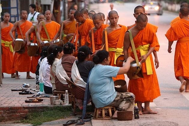 Morning Alms Ceremony - best laos classic tours
