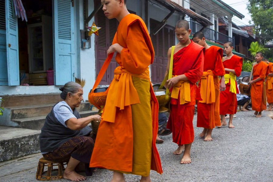 morning alms giving in laos