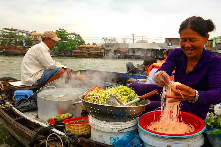 the floating market in mekong delta